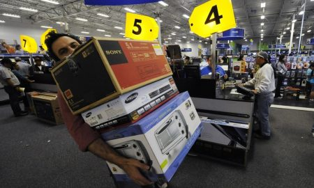 Shoppers look for bargains during Black Friday sales at a Best Buy store in Glendale, California